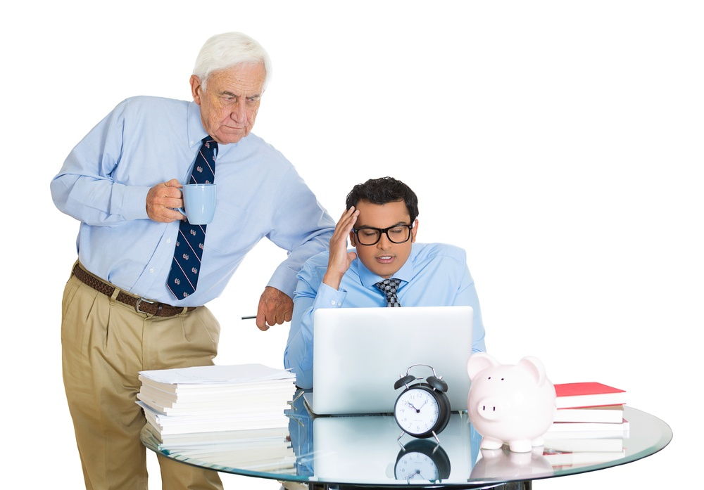 Closeup portrait of old elderly business man boss, checking on his young employee, pushing to work hard on project, who is in disagreement unhappy, isolated on white background. Conflict at work place.jpeg